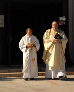 #10 The priests exiting the church after the service