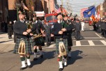 #15 The Emerald Society Pipe and Drums leading the procession after the service