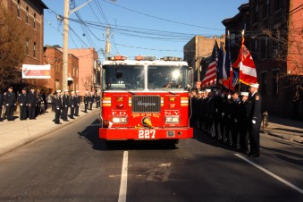 #2 The funeral cortege was led by a new modern fire engine........