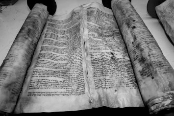 # 21 A Torah that was severly damaged in the storm must be buried according to Jewish law