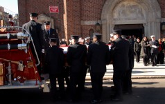 #6 The pallbearers removing the casket from the funeral caisson